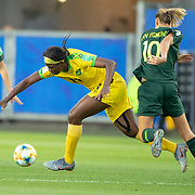 GRENOBLE, FRANCE June 18.  Khadija Shaw #11 of Jamaica is fouled by Emily van Egmond #10 of Australia during the Jamaica V Australia, Group C match at the FIFA Women's World Cup at Stade des Alpes on June 18th 2019 in Grenoble, France. (Photo by Tim Clayton/Corbis via Getty Images)