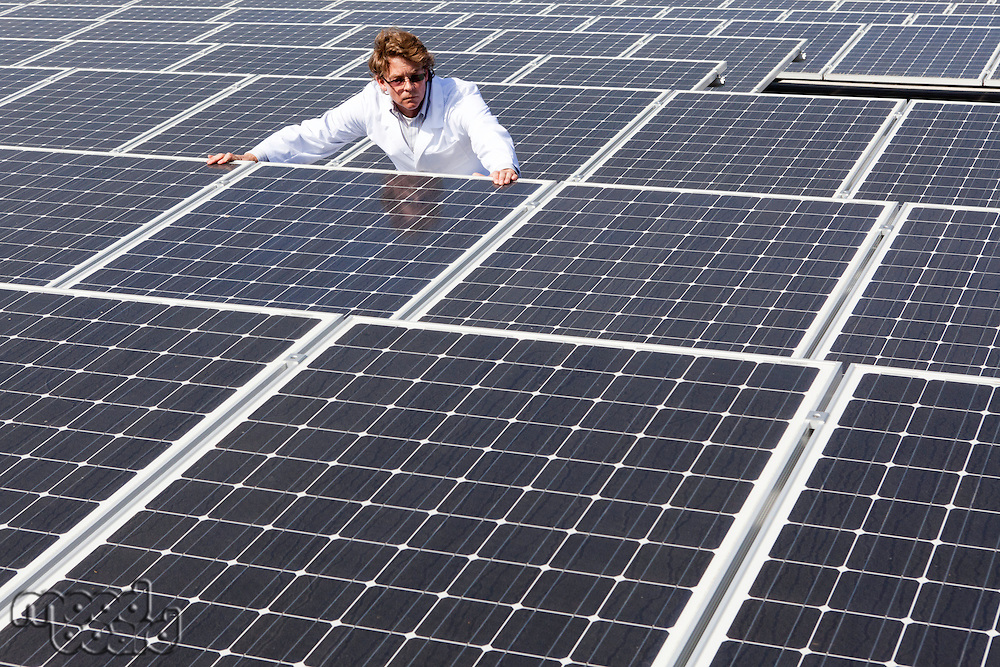 Man surveying solar panels