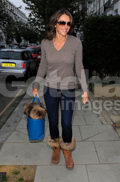 Actress Elizabeth Hurley returns home from filming The Royals and and makes a quick change into cream dress and fur shawl to attend the Woodside End Of Summer Party held in Windsor, London, UK. 04/09/2014<br />BYLINE MUST READ : GOTCHAIMAGES.COM<br /><br />Copyright by &copy; Gotcha Images Ltd. All rights reserved.<br />Usage of this image is conditional upon the acceptance <br />of Gotcha Images Ltd, terms and conditions available at<br />www.gotchaimages.com