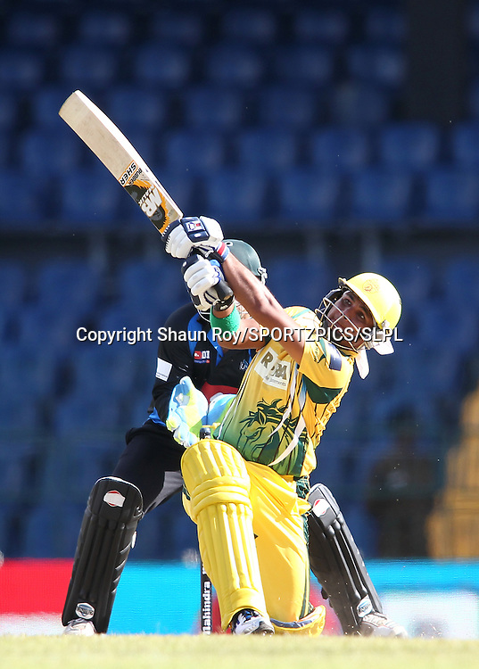 Imran Farhat of Uthura Rudras hits over the top during match 3 of the Sri Lankan Premier League between Uthura Rudras and Wayamba United held at the Premadasa Stadium in Colombo, Sri Lanka on the 11th August 2012<br />  <br /> Photo by Shaun Roy/SPORTZPICS/SLPL