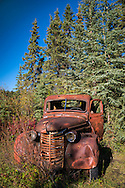 Yukon Territory, Canada, September 2014. An old truck rusts away next to a log cabin at Lower Laberge. During this Yukon River canoe trip we paddled part of the Klondike Gold Rush route of 1898. We camped on the banks of the Yukon River in authentic northern wilderness and explored the gold rush relics on the way. Photo by Frits Meyst / MeystPhoto.com
