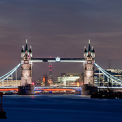 Tower Bridge and the dome of St. Paul's Cthedral in London at dusk. Long exposure.