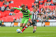Grimsby Town's Nathan Arnold tackles Forest Green's Elliott Frear during the Conference Premier Final match between Forest Green Rovers and Grimsby Town FC at Wembley Stadium, London, England on 15 May 2016. Photo by Shane Healey.
