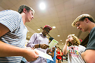 A group of students checks out the program at Sunburst Festival at Memorial Union in 2014.