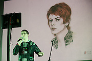 """Justin Curtis of Perinton performs karaoke (""""Starman"""") at Bowioke at Visual Studies Workshop in Rochester on Saturday, October 31, 2015. The night included David Bowie karaoke and a reenactment of Bowie's 1976 arrest in Rochester."""