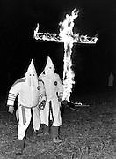 Hooded Klansmen at cross burning at Ku Klux Klan rally - Macon, Georgia - 1975.