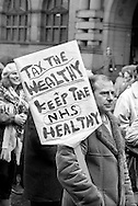 5000 people marched to a rally calling on the Chancellor to increase funding for the NHS in the Budget among the marchers were factory. council and bus workers who had gone on strike to attend the march. Sheffield 14.3.88