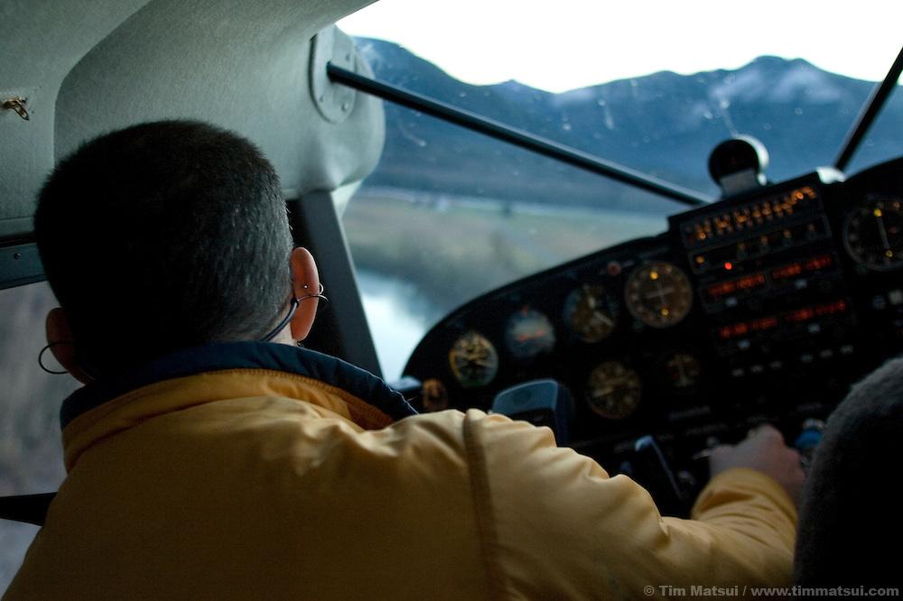 Pilot Tom Unger maneuvers his light plane over the Skagit River, Washington.
