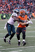 Philadelphia Eagles outside linebacker Nigel Bradham (53) knocks the ball out of Cincinnati Bengals offensive tackle Jake Fisher (74) hand after Fisher catches a fourth quarter pass good for a gain of 12 yards prior to the fumble during the 2016 NFL week 13 regular season football game against the Cincinnati Bengals on Sunday, Dec. 4, 2016 in Cincinnati. The Bengals won the game 32-14. (©Paul Anthony Spinelli)