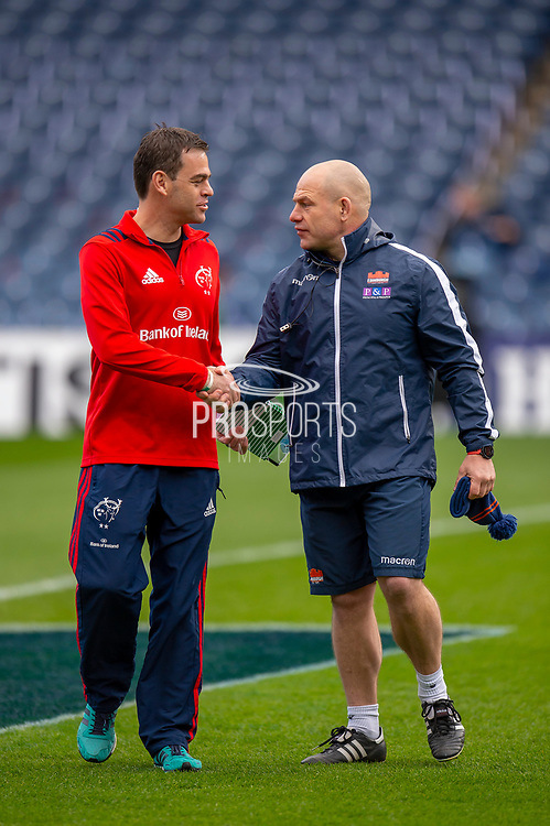 Richard Cockerill, Head Coach of Edinburgh Rugby (right) shakes hands with Munster head coach Johann van Graan before the Heineken Champions Cup quarter-final match between Edinburgh Rugby and Munster Rugby at BT Murrayfield Stadium, Edinburgh, Scotland on 30 March 2019.