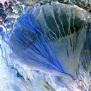 """Image from the USGS Landsat Project: """"A vast alluvial fan blossoms across the desolate landscape between the Kunlun and Altun mountain ranges that form the southern border of the Taklimakan Desert in China's XinJiang Province."""""""