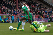 Ntumba Massanka (on loan from Burnley) (Wrexham AFC) gets the ball past Scott Loach (York City) but the shot goes wide during the Vanarama National League match between York City and Wrexham FC at Bootham Crescent, York, England on 17 April 2017. Photo by Mark P Doherty.
