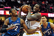 Feb. 13, 2011; Cleveland, OH, USA; Cleveland Cavaliers power forward J.J. Hickson (21) fights Washington Wizards point guard John Wall (2) for a rebound during the fourth quarter at Quicken Loans Arena. The Wizards beat the Cavaliers 107-93 for their first win on the road this season. Mandatory Credit: Jason Miller-US PRESSWIRE