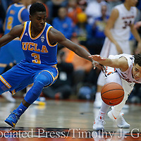 UCLA's Aaron Holiday, left, and Oregon State's JaQuori McLaughlin chase after a loose ball during the first half of an NCAA college basketball game in Corvallis, Ore., on Friday Dec. 30, 2016. (AP Photo/Timothy J. Gonzalez)