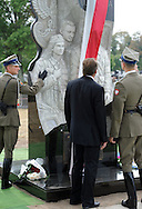 Soldiers and staff view the monument before the visit of Poland President Andrzej Duda at the memorial Tomb of Fallen Soldiers killed by Communists from 1944-63 Sunday, September 18, 2016 in New Britain, Pennsylvania.  (Photo by William Thomas Cain)