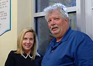 Garden City, New York, USA. March 9, 2019. L-R, Hempstead Town Supervisor LAURA GILLEN and Commissioner of Sanitation District 2 and Baldwin resident JOHN COOLS, pause chatting to pose for photo at Unveiling Ceremony of mural by painter Michael White of Nunley's Carousel lead horse. Event was held at historic Nunley's Carousel in its Pavilion on Museum Row on Long Island.