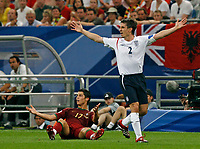 Photo: Glyn Thomas.<br />England v Portugal. Quarter Finals, FIFA World Cup 2006. 01/07/2006.<br /> England's Gary Neville (R) and Portual's Cristiano Ronaldo protest to the referee.