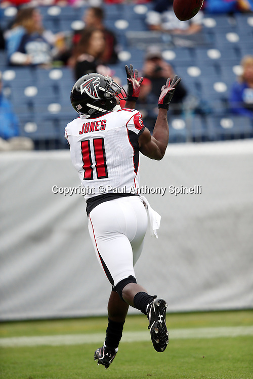Atlanta Falcons wide receiver Julio Jones (11) reaches for an end zone pass while warming up before the 2015 week 7 regular season NFL football game against the Tennessee Titans on Sunday, Oct. 25, 2015 in Nashville, Tenn. The Falcons won the game 10-7. (©Paul Anthony Spinelli)