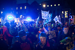 © Licensed to London News Pictures. 09/10/2019. London, UK. Extinction Rebellion protesters march in Parliament Square . Police continue to attempt to clear roads in Westminster on the third day of the protest.  Photo credit: George Cracknell Wright/LNP