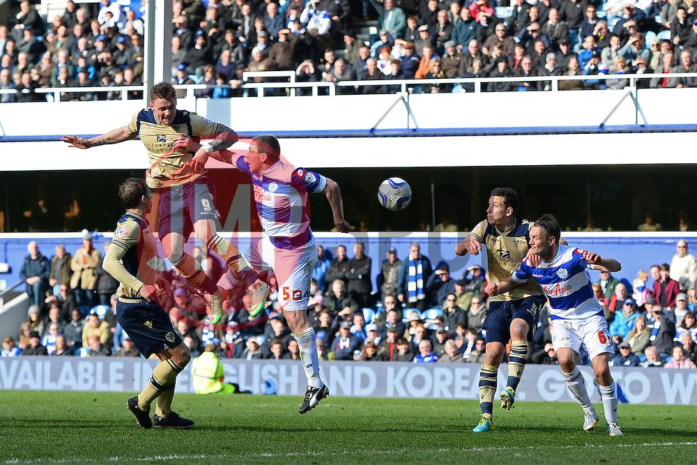 Leeds United's Connor Wickham heads the ball towards the QPR goal - Photo mandatory by-line: Mitchell Gunn/JMP - Tel: Mobile: 07966 386802 01/03/2014 - SPORT - FOOTBALL - Loftus Road - London - Queens Park Rangers v Leeds United - Championship