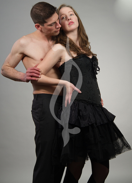 Couple posing together in burleque clothing.