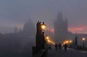 Sunrise at the Charles Bridge or Karluv most, built 1357 - 15th century, looking towards the Old Town bridge tower, across the Vltava river in Prague, Czech Republic. Its construction began under King Charles IV, replacing the old Judith Bridge built 1158'??1172 after flood damage in 1342. This new bridge was originally called the Stone Bridge (Kamenny most) or the Prague Bridge (Prazsky most) but has been the Charles Bridge since 1870. The bridge is 621m long and nearly 10m wide, resting on 16 arches shielded by ice guards. It is protected by three bridge towers, two on the Lesser Quarter side and one in Gothic style on the Old Town side. The historic centre of Prague was declared a UNESCO World Heritage Site in 1992. Picture by Manuel Cohen