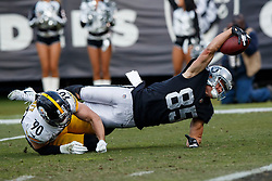 OAKLAND, CA - DECEMBER 09: Tight end Derek Carrier #85 of the Oakland Raiders reaches for extra yardage over defensive tackle Johnathan Hankins #90 of the Oakland Raiders during the third quarter at the Oakland Coliseum on December 9, 2018 in Oakland, California. The Oakland Raiders defeated the Pittsburgh Steelers 24-21. (Photo by Jason O. Watson/Getty Images) *** Local Caption *** Derek Carrier; T.J. Watt