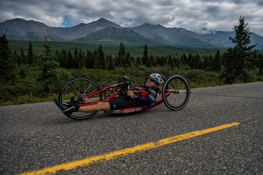 July 25, 2015: Wesley Bergin races along Denali Park Road during stage five of the 2015 Alaska Challenge handcycle race.