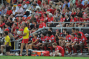 """Reds bench look on during an anxious moment in the Super 15 Rugby Union match (Round 7) between the Queensland Reds and the ACT Brumbies played at Suncorp Stadium (Brisbane, Australia) on Good Friday 6th April 2012 ~ Queensland (20) defeated the Brumbies (13) ~ This image is intended for Editorial use only - Required Images Credit """"Steven Hight - Aura Images"""""""