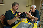 PENSACOLA, Fla. (Oct. 28, 2009) -- U.S. Navy photo veteran and Nikon technical representative Mark Kettenhoffen talks shop with past president of the National Association of Naval Photography (NANP) John Lewin during a reunion in Pensacola Beach, Florida for a week long event of tours, meetings and awards banquet.  Photo by Johnny Bivera