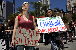 May 24, 2019, Los Angeles, California, U.S.: Protesters are seen holding placards during a climate change demonstration..Students and environmental activists participate in a Climate Strike in Los Angeles, California. Organizers called on the Trump Administration to declare a state of climate emergency in order to save the planet, create a Green New Deal and transition into a zero emissions economy. (Credit Image: © Ronen Tivony/SOPA Images via ZUMA Wire)