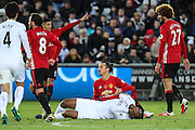 Zlatan Ibrahimovic of Manchester United is booked, for a tackle on Leroy Fer of Swansea City during the Premier League match between Swansea City and Manchester United at the Liberty Stadium, Swansea, Wales on 6 November 2016. Photo by Andrew Lewis.