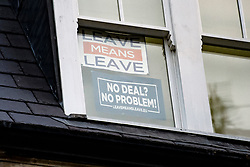 "© Licensed to London News Pictures. 29/01/2019. London, UK. Signs reading ""LEAVE MEANS LEAVE"" and ""NO DEAL?, NO PROBLEM!"" In the window of Brexiteer JACOB REES-MOGG's home in Westminster, London. MPs will today (Tues) vote on a series of amendments to the Prime Minister's plans that could shape the future direction of Brexit. . Photo credit: Ben Cawthra/LNP"