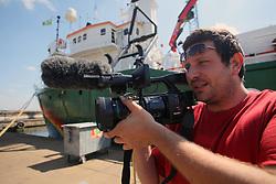 NETHERLANDS AMSTERDAM 11MAY11 - Cameraman Mario Poeta of Italy aboard the Arctic Sunrise...Photo by Jiri Rezac / Greenpeace