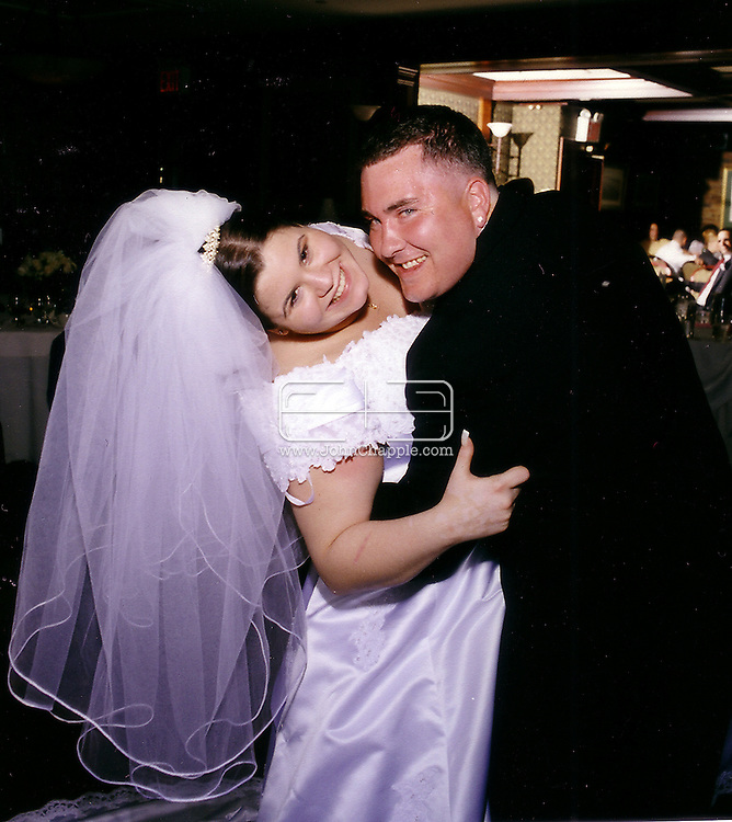 23rd August 2007. San Marcos, California. Identity theft bride and groom, Denise and Kevin Reilly. The New Yorkers had their wedding day ruined in 2004 when they applied for a wedding certificate and were denied. The couple discovered that Denise was the victim of identity fraud and somebody else had married using her name and social security number. They were finally awarded their marriage certificate three years after their wedding day. Picture shows the couple on their 2004 wedding day. PHOTO SUPPLIED SUPPLIED BY JOHN CHAPPLE / REBEL IMAGES.tel 310 570 9100.john@chapple.biz  www.chapple.biz