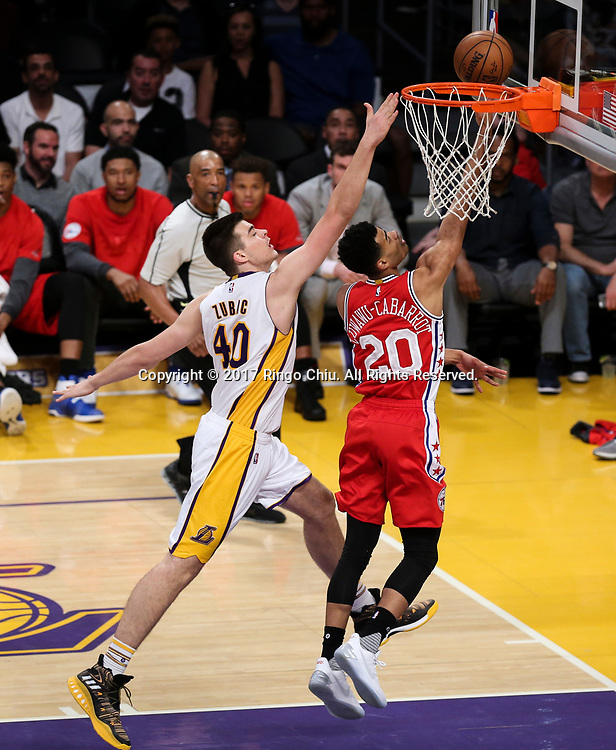 Los Angeles Lakers center Ivica Zubac (#40) tries to block a shot by Philadelphia 76ers guard Timothe Luwawu-Cabarrot (#20) during an NBA basketball game Tuesday, March 12, 2017, in Los Angeles. <br /> (Photo by Ringo Chiu/PHOTOFORMULA.com)<br /> <br /> Usage Notes: This content is intended for editorial use only. For other uses, additional clearances may be required.