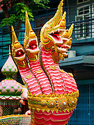 18 NOVEMBER 2015 - BANGKOK, THAILAND:  A naga (mythical serpent) leads the Wat Saket annual fair parade. Wat Saket is on a man-made hill in the historic section of Bangkok. The temple has golden spire that is 260 feet high which was the highest point in Bangkok for more than 100 years. The temple construction began in the 1800s in the reign of King Rama III and was completed in the reign of King Rama IV. The annual temple fair is held on the 12th lunar month, for nine days around the November full moon. During the fair a red cloth (reminiscent of a monk's robe) is placed around the Golden Mount while the temple grounds hosts Thai traditional theatre, food stalls and traditional shows.     PHOTO BY JACK KURTZ