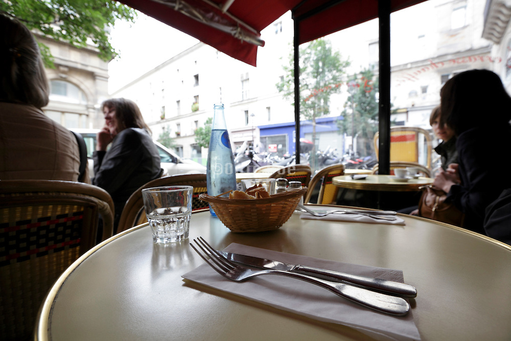a typical Paris sidewalk terrace with bread basket and utensils
