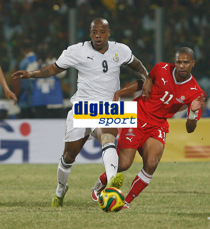 Photo: Steve Bond/Richard Lane Photography.<br />Ghana v Namibia. Africa Cup of Nations. 24/01/2008. Junior Agogo (L) fends off the attentions of Sydney Plaatjies(R)