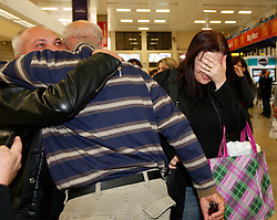 Maltese evacuees from Tripoli in Libya are welcomed back home by relatives at Malta International Airport, outside Valletta, February 21, 2011..Photo by Darrin Zammit Lupi