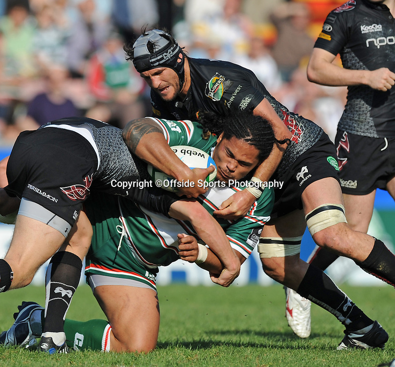 12/10/2008. Rugby Union. Heineken Cup, Pool 3. Leicester Tigers v Ospreys. Alesana Tuilagi is tackled by Marty Holah. Leicester, UK. Photo: Offside/Steve Bardens.