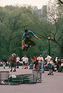 A roller blade jumper in Central Park, New York City, 1994.