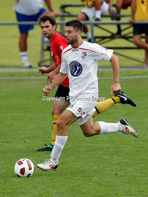 Waitakere's Chris Bales beats Waikato's Jack Beguely. ASB Premiership, Waitakere United v Waikato FC, Fred Taylor Park Whenuapai, Saturday 19th February 2011. Photo: Shane Wenzlick