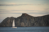 A sailboat out for a sunset cruise in the Cabo San Lucas Harbor in Baja Sur, Mexico.