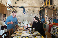 CETARA, ITALY - 10 March 2014: Daniele De Michele (right) tastes olives in the farmhouse of Antonio Polverino (65, left),  in Cetara, a village of fishermans in the Amalfi Coast, Italy, on March 10th 2014.<br /> Antonio Polverino was interviewed by Daniele De Michele, aka Donpasta, a DJ-economist with a passion for gastronomy.