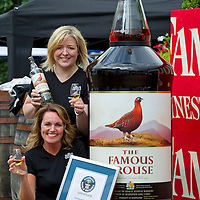 12.8.2012. Its a record winner.... The largest bottle of whisky in the world is now to be found in Crieff at the Famous Grouse Experience (FGE). In total 228 Ltr bottles of whisky were used to fill the giant bottle, with a street price of around £4500.<br /> Tracy McCafferty, the General Manager of the FGE holds the Guinness certificate and toasts the sucesfull record attempt with Katy Stollery the Famous Grouse PR manager who poured the 185th bottle which took the attempt passed the previous largest bottle of Jack Daniels. COPYRIGHT: Perthshire Picture Agency.<br /> Tel. 01738 623350 / 07775 852112.