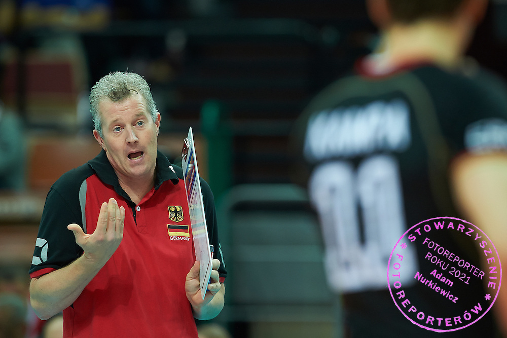 Germany's trainer coach Vital Heynen speaks with his players while volleyball match between Germany and Iran during the 2014 FIVB Volleyball World Championships at Spodek Hall in Katowice on September 17, 2014.<br />
