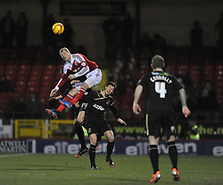 Swindon Town's James McEveley wins a high ball over Crawley Town's Jamie Proctor - Photo mandatory by-line: Alex James/JMP - Tel: Mobile: 07966 386802 25/02/2014 - SPORT - FOOTBALL - Swindon - county ground - Swindon Town v Crawley - Sky Bet League One