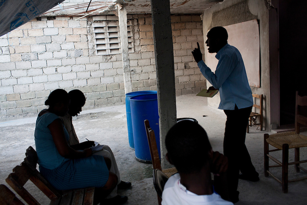A bible study class takes place on a borrowed rooftop on July 8, 2010 in Port-au-Prince, Haiti. With many churches destroyed, congregations are forced to improvise and find temporary spaces for their activities.