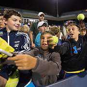 August 21, 2014, New Haven, CT:<br /> Fans ask for autographs during the Men's Legends Event on day seven of the 2014 Connecticut Open at the Yale University Tennis Center in New Haven, Connecticut Thursday, August 21, 2014.<br /> (Photo by Billie Weiss/Connecticut Open)